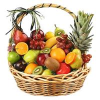 Fruit basket with pineapple, bananas, orange, apples, grapes, lemon, pear