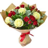 Delicate bouquet of white roses and red bush roses