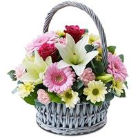 Basket with lilies, roses, gerberas and chrysanthemums