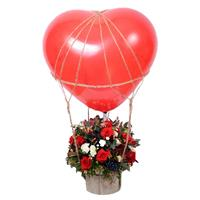 Beautiful composition of roses, chrysanthemums and balloons