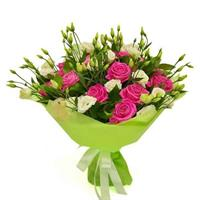 Bouquet of roses and eustomas with greens