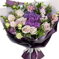 Delicate bouquet with imported roses and eustoma