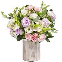 Bright composition of roses, eustom and alstroemeria