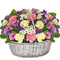 basket with white chrysanthemum, red rose, decorative greens.