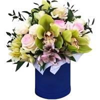 A box with orchids, roses and, eustoma and alstroemerias.