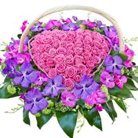 Heart of pink roses and white chrysanthemums