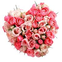 Arrangement of pink and cream roses in the form of a heart