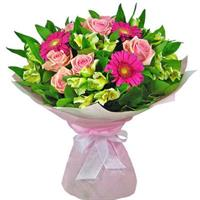 Bouquet of pink roses, pink gerberas and cream alstroemeria