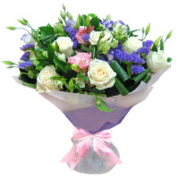A bouquet of white roses, white and pink eustoma and purple freesia