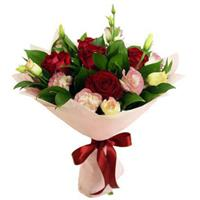 Bouquet of roses, lilies, carnations, freesia and ranunkulyusov