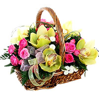 Basket with orchids and rose