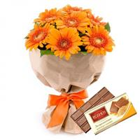 Bouquet of 7 multicolored gerberas, Milk chocolate Roshen as a gift.