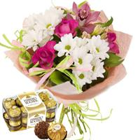 Bouquet of gerberas and chrysanthemums, chocolates Ferrero Rocher as a gift.