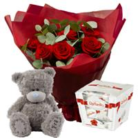 Bouquet of 7 roses, a teddy bear