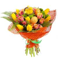 Easter basket of tulips, chrysanthemums and greens