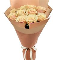 A wonderful bouquet of cream roses and bush roses.