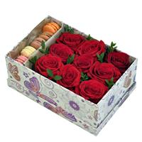 Box with red roses and macaroons