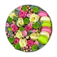 Macaroons and flowers in a box