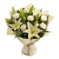 Charming bouquet of lilies and delicate roses
