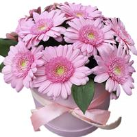 Charming bouquet of gerberas, bush roses and alstroemerias in a box