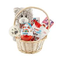 Basket with a toy and sweets